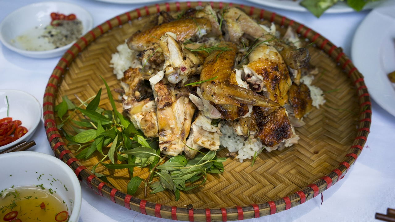 A delicious Vietnamese grilled chicken served on a bamboo plate